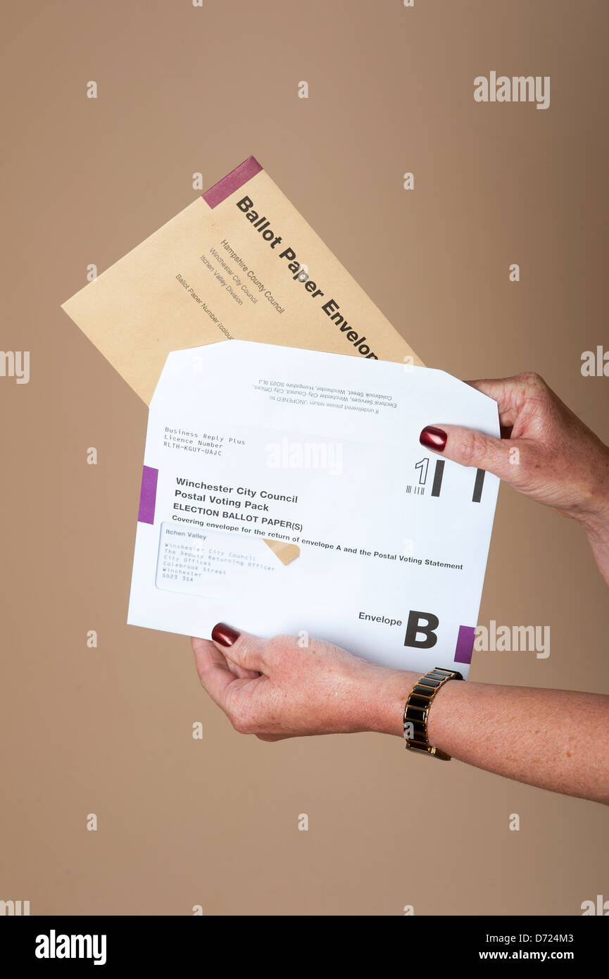 Postal voting the ballot paper envelope being inserting into the posting envelope - Stock Image