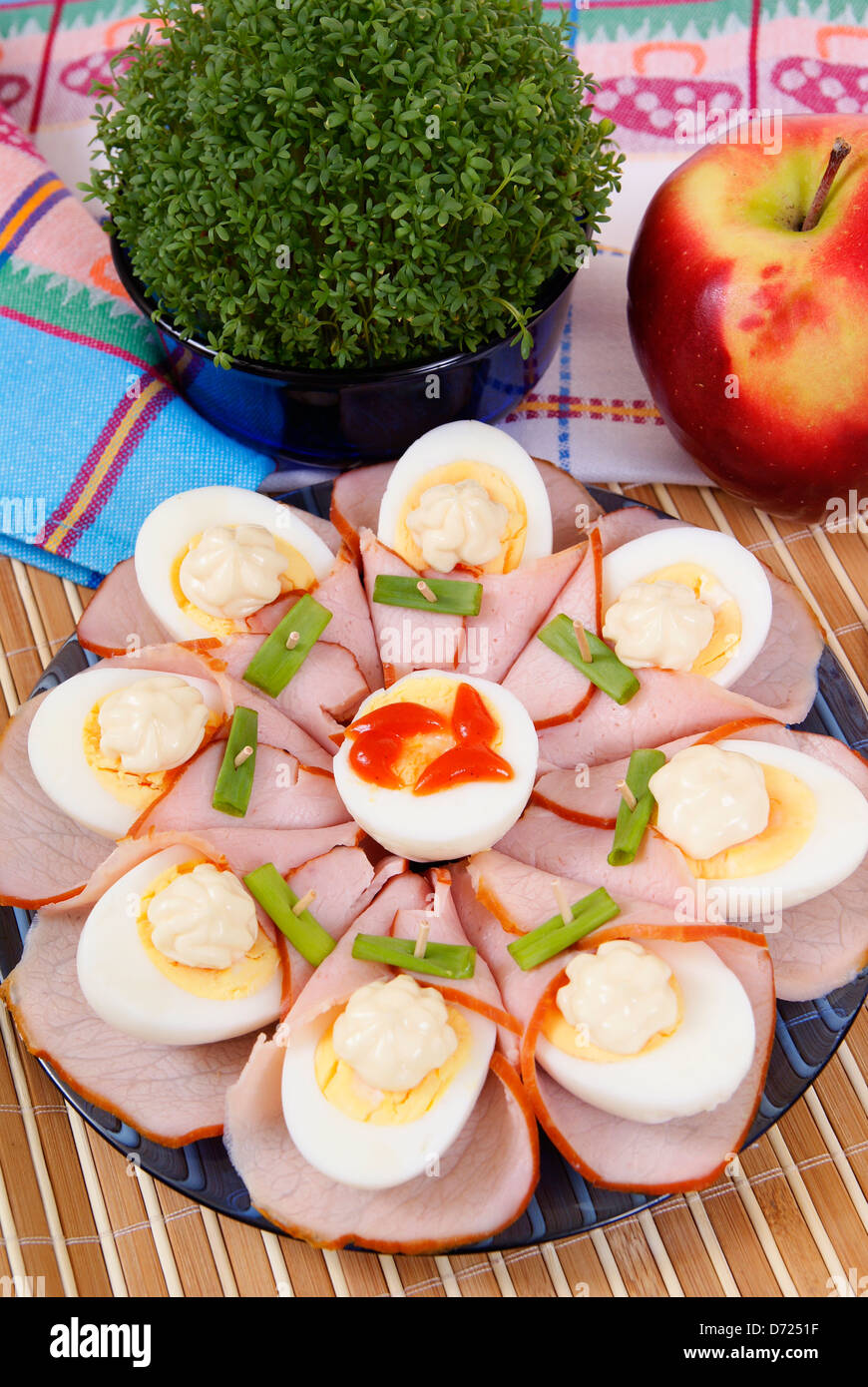 halfes of eggs with cress made as background - Stock Image