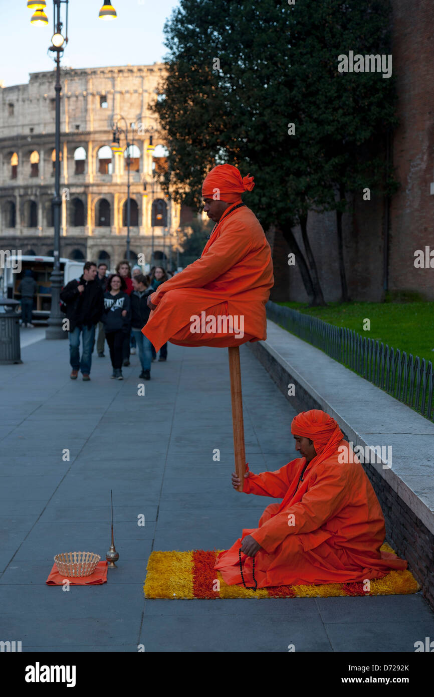 Indian street entertainers outside The Colosseum in Rome, Italy - Stock Image