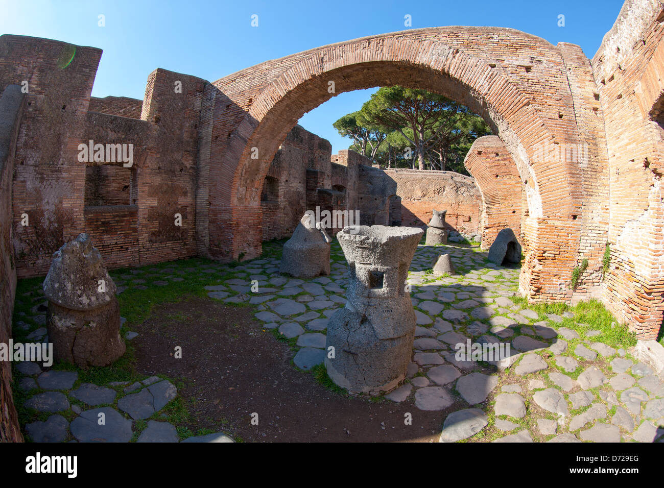 A Roman Bakery in Ostia Antica, with carved pumice millstones for grinding corn - Stock Image