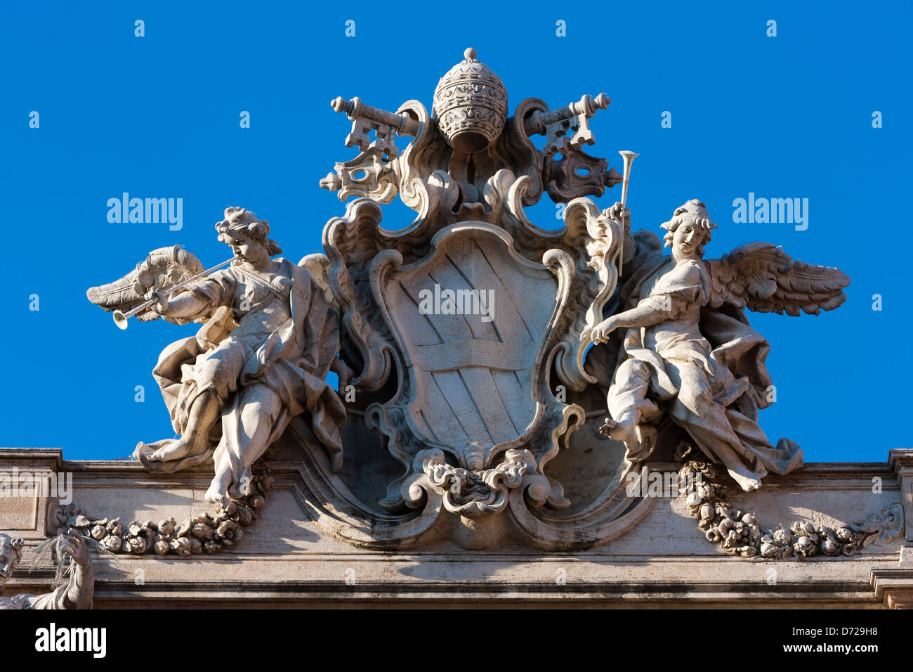 The heraldic shield at the top of the Trevi Fountain, Rome, Italy - Stock Image