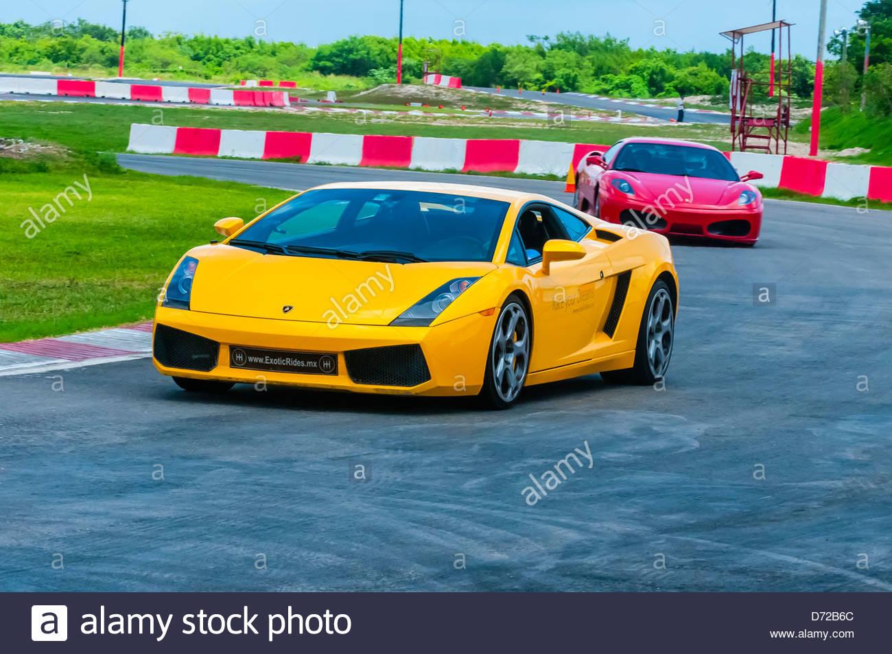Lamborghini Gallardo Yellow And Ferrari F430 Red On The Track At