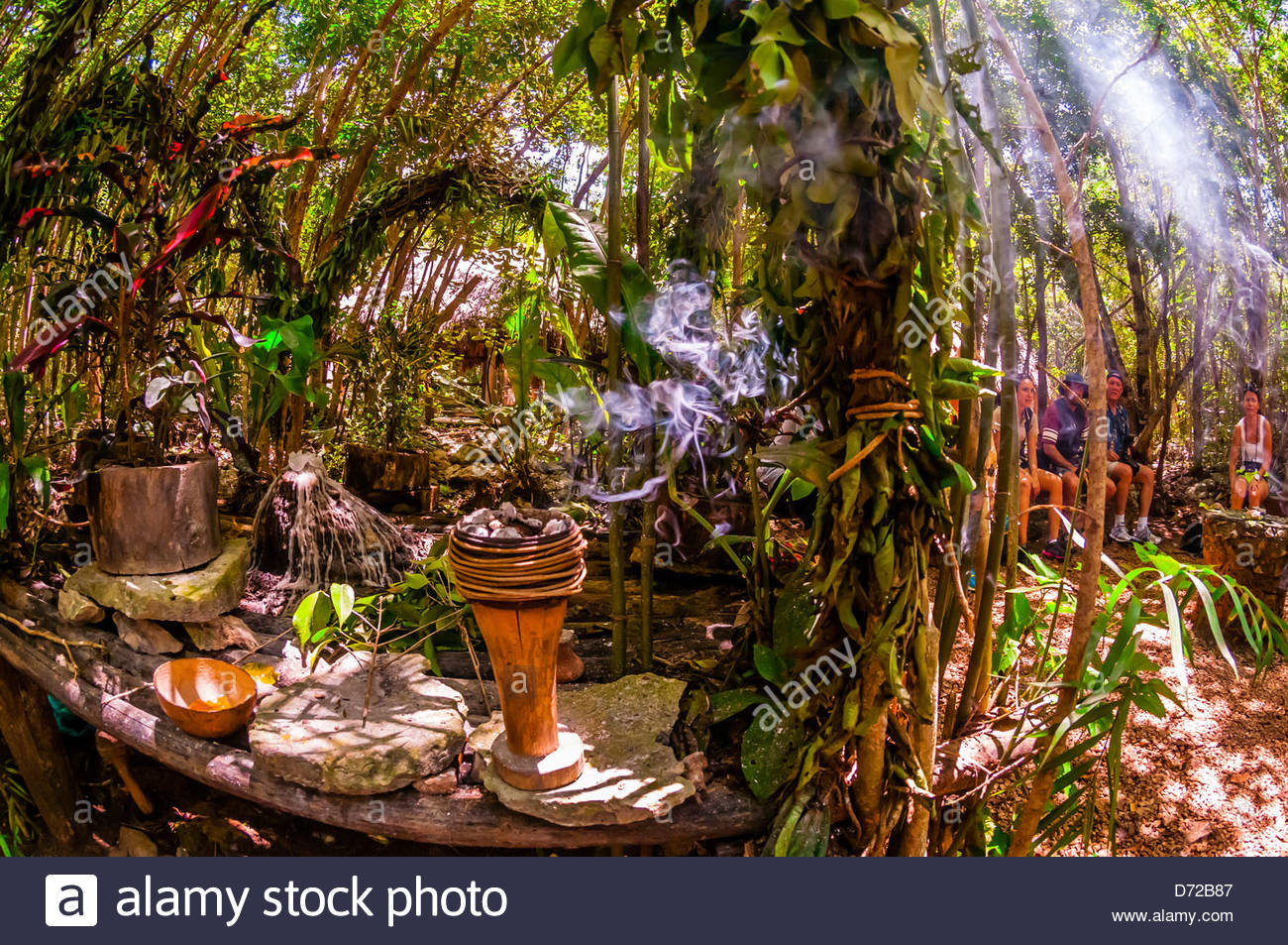 A Mayan shaman performing a purification ceremony in the jungle, near Riviera Maya, Mexico - Stock Image