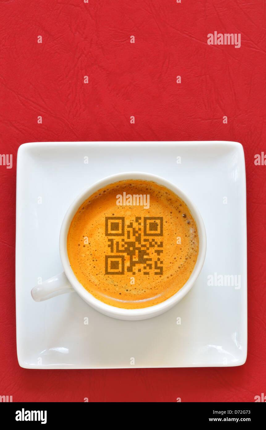 Cup of espresso and smartphones code shoot in studio - Stock Image