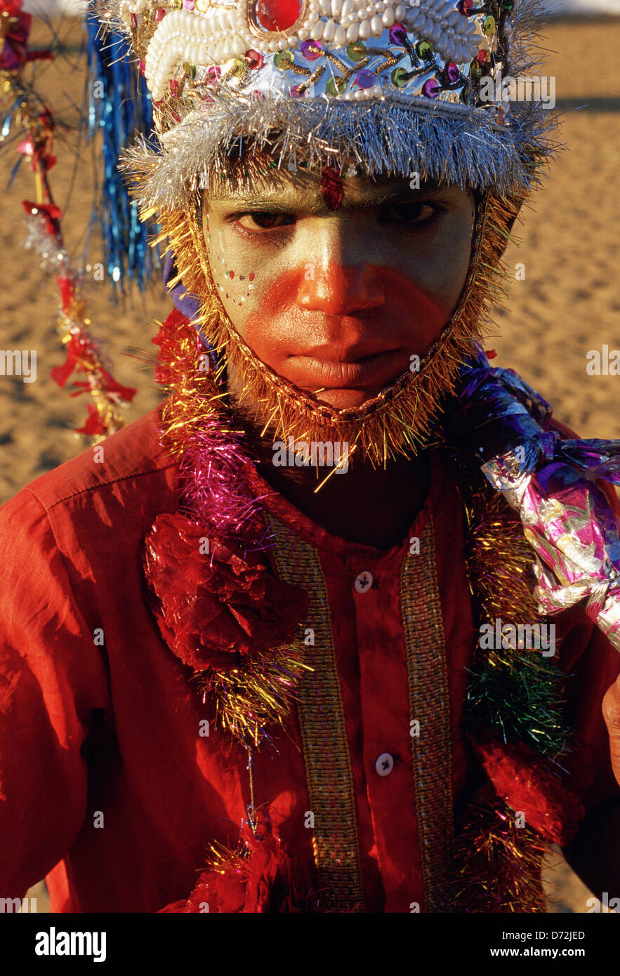 A hindu boy is made up and dressed like Hanuman, the monkey god ( India) - Stock Image
