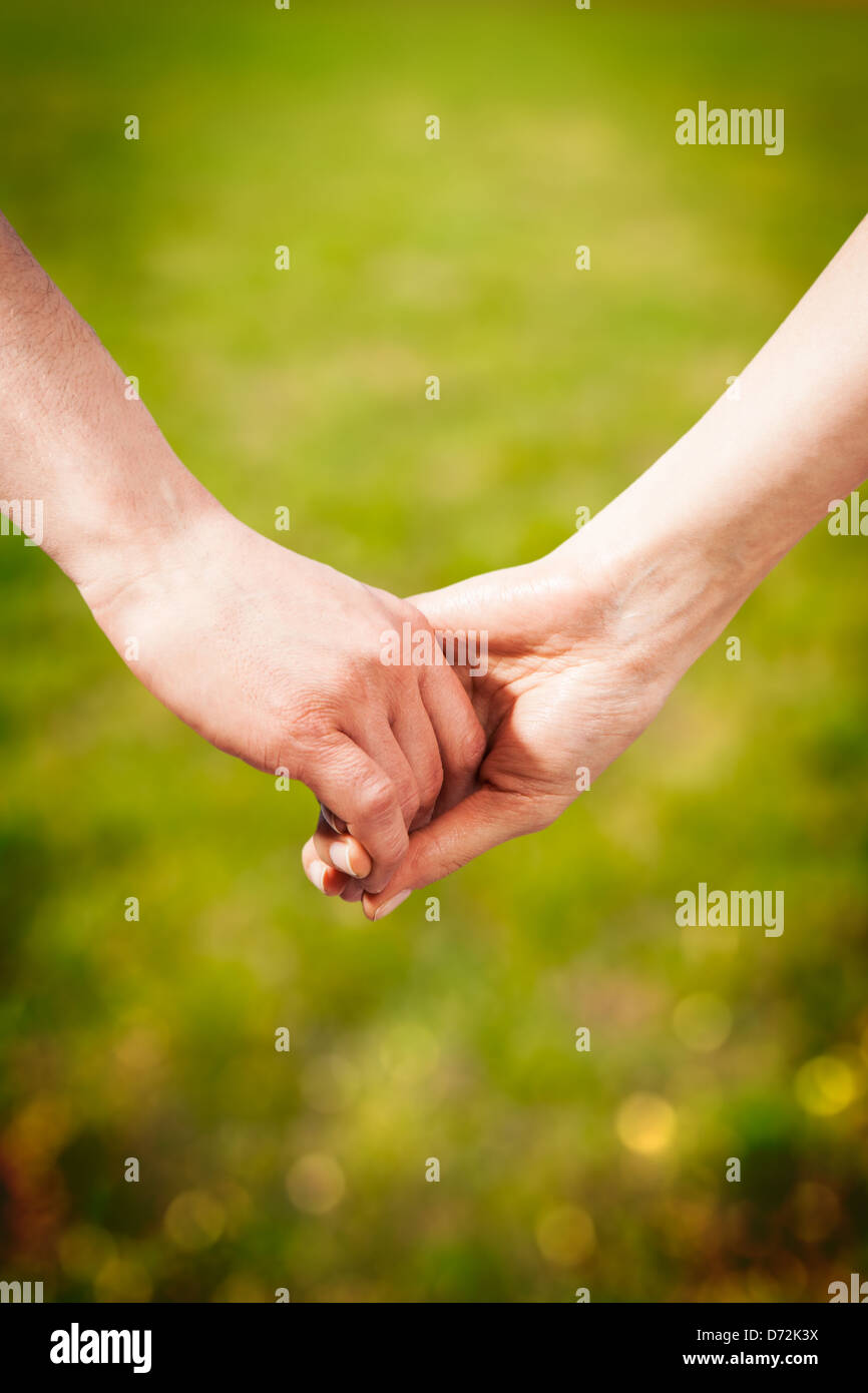 Close-up Holding Hands - Stock Image
