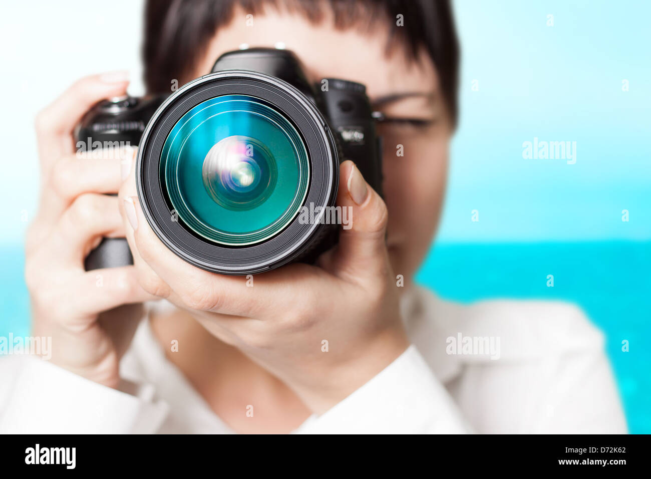 Pretty woman is a professional photographer with dslr camera Stock Photo