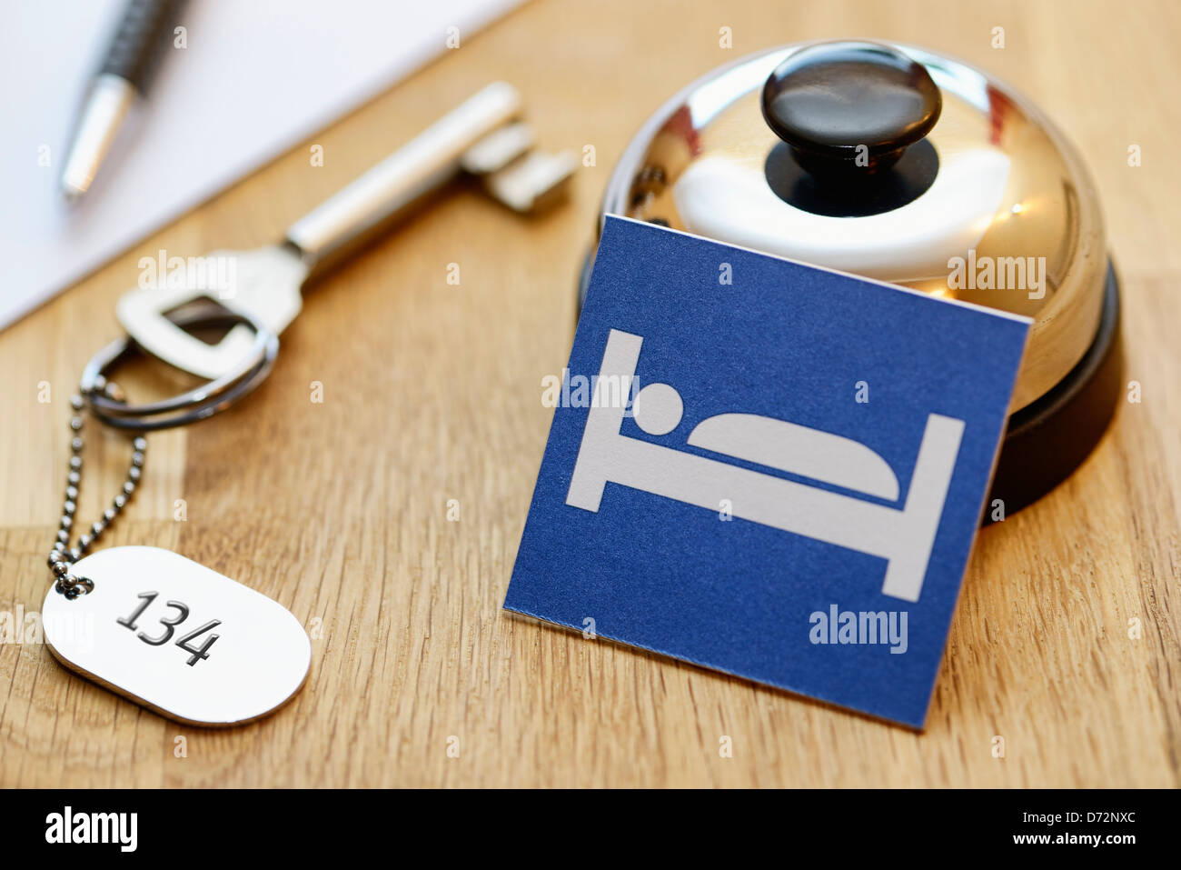 Bell and room key one of an adoption, symbolic photo Bed-expensive - Stock Image