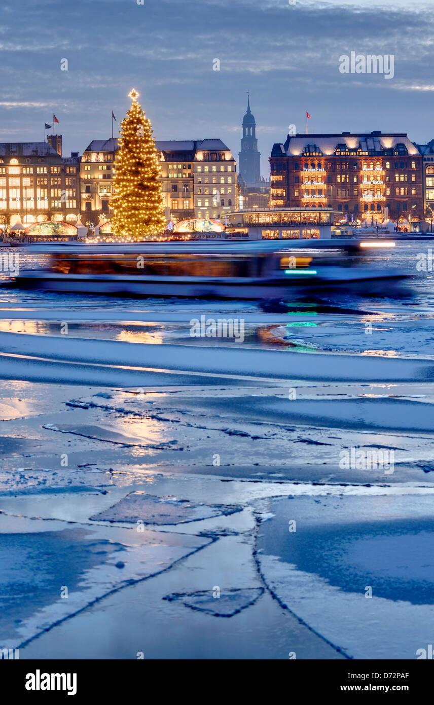 The Inner Alster with Christmas fir and Jungfernstieg in Hamburg, Germany, Europe - Stock Image