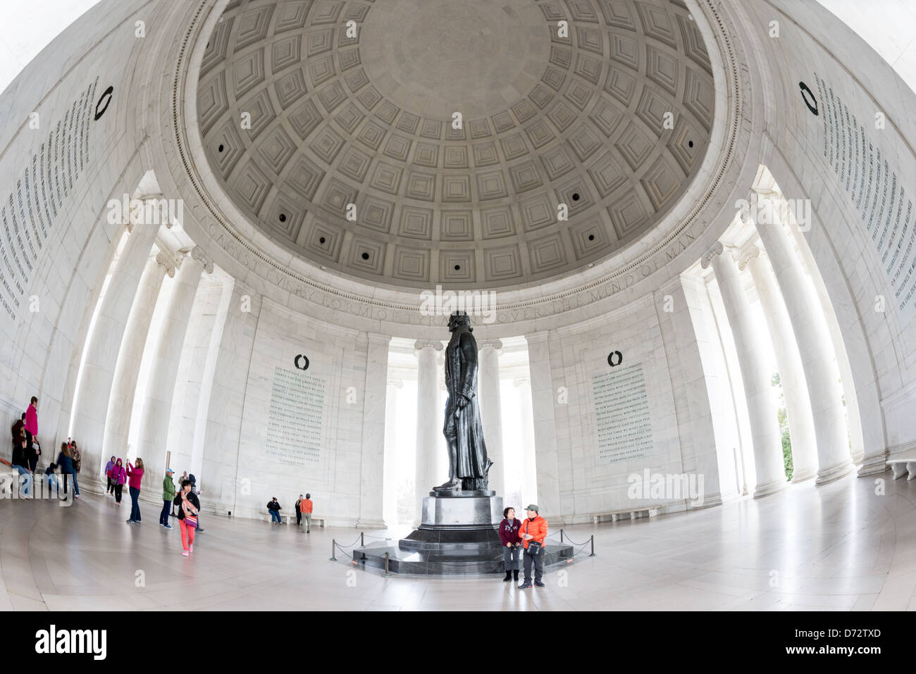 WASHINGTON DC, USA - A wide-angle shot of tourists visiting inside the Jefferson Memorial, on the banks of the Tidal Basin in Washington DC. Stock Photo