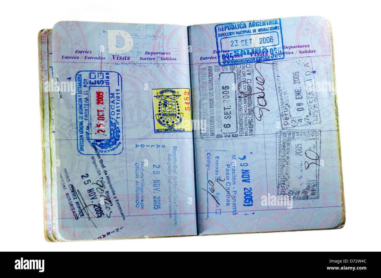 Inside pages and stamps of a well used American passport isolated on white - Stock Image