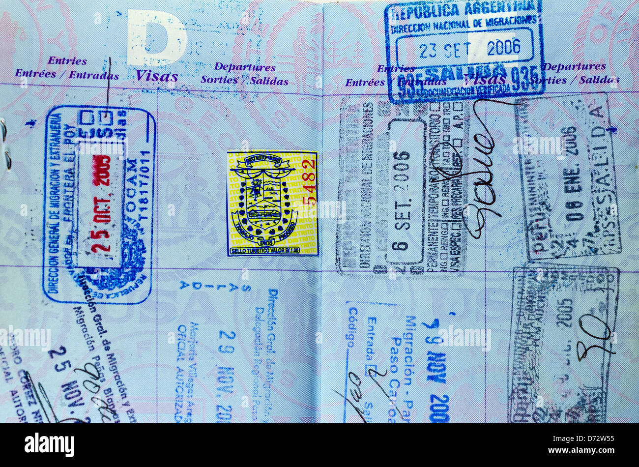 Closeup view of well used passport pages and stamps - Stock Image