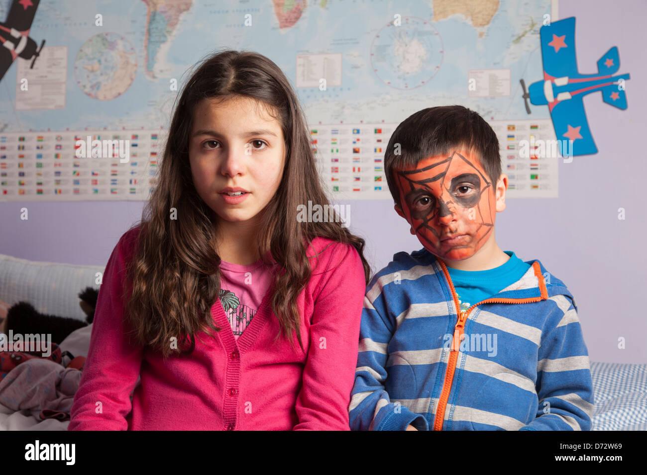 Siblings in their room - Stock Image