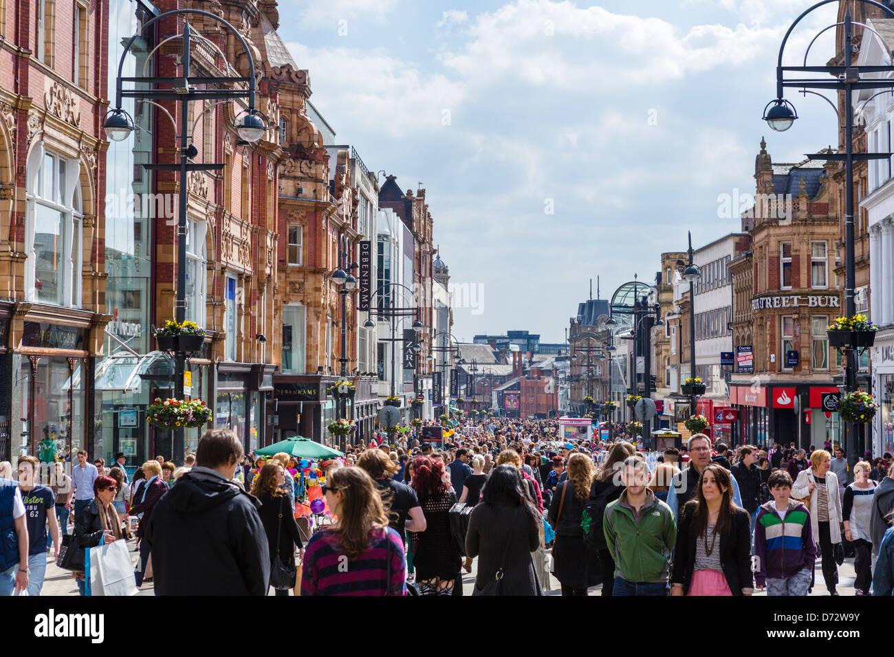 Crowded shopping street on a Saturday morning, Briggate, Leeds, West Yorkshire, UK - Stock Image