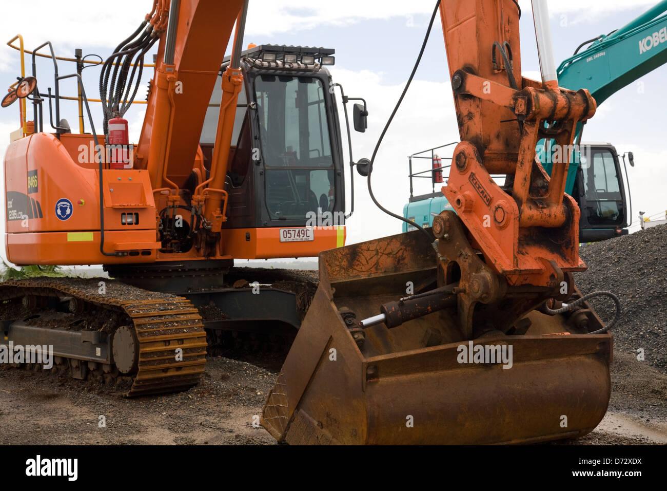 excavators on pacific highway project,australia - Stock Image