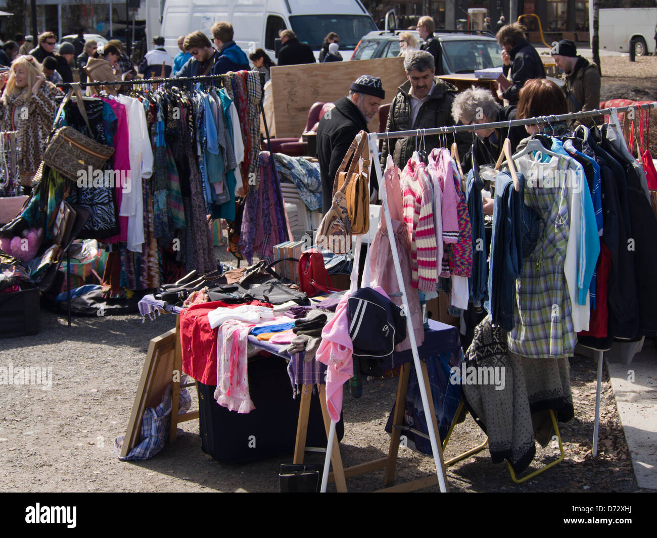 Stall With Used Clothes Vendor And Buyers In A Flea Market In Stock Photo Alamy