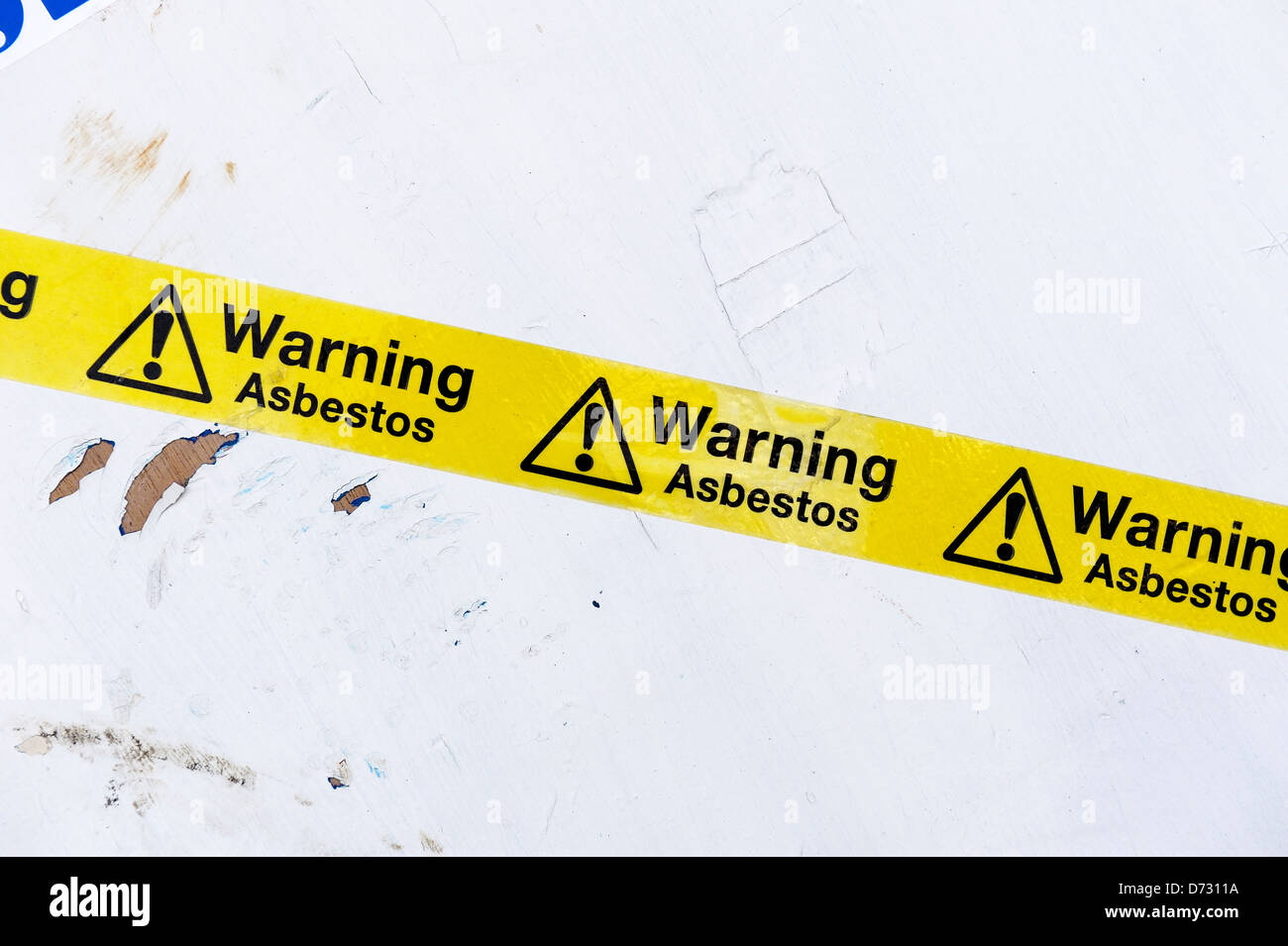 warning asbestos tape on asbestos panels - Stock Image