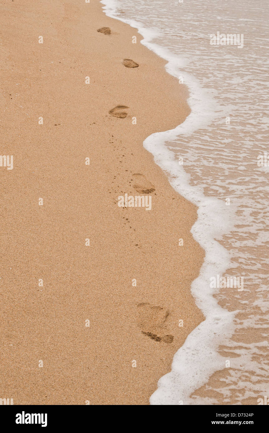 Footprint in the sand at the seaside - Stock Image