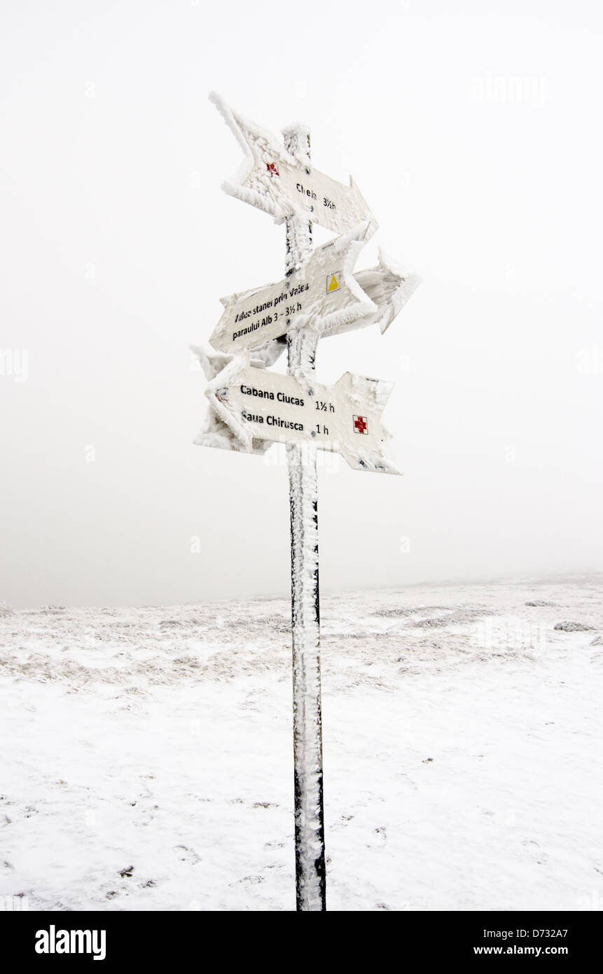 Mountain indicator in Ciucas mountains, Romania, during the winter - Stock Image