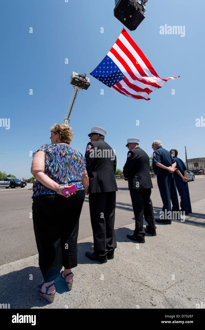 April 27, 2013 - West, Texas, U.S -  Firefighters drape a large American flag over the funeral procession for Buck - Stock Image