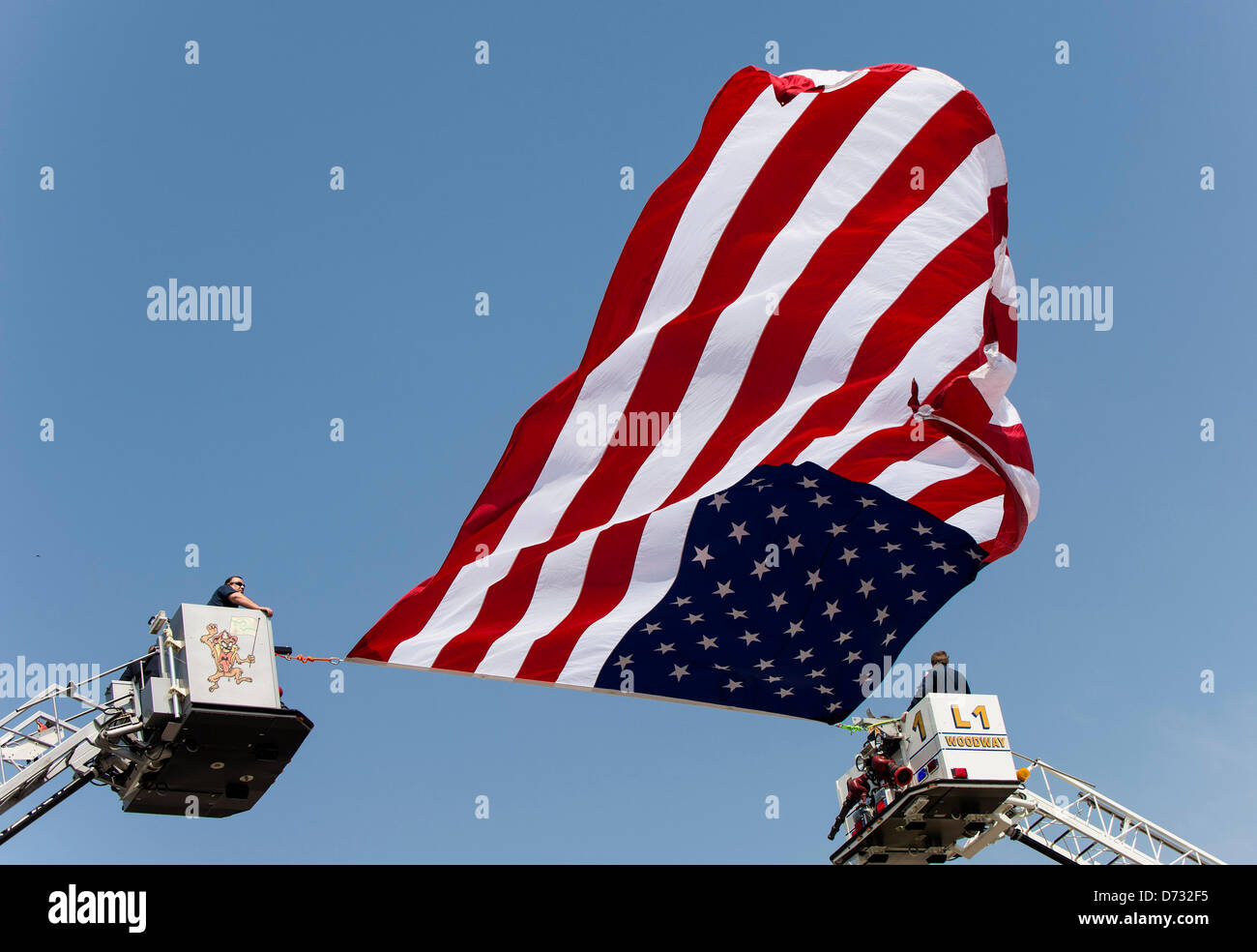 April 27, 2013 - West, Texas, U.S -  Firefighters drape a large American flag over the funeral procession through Stock Photo