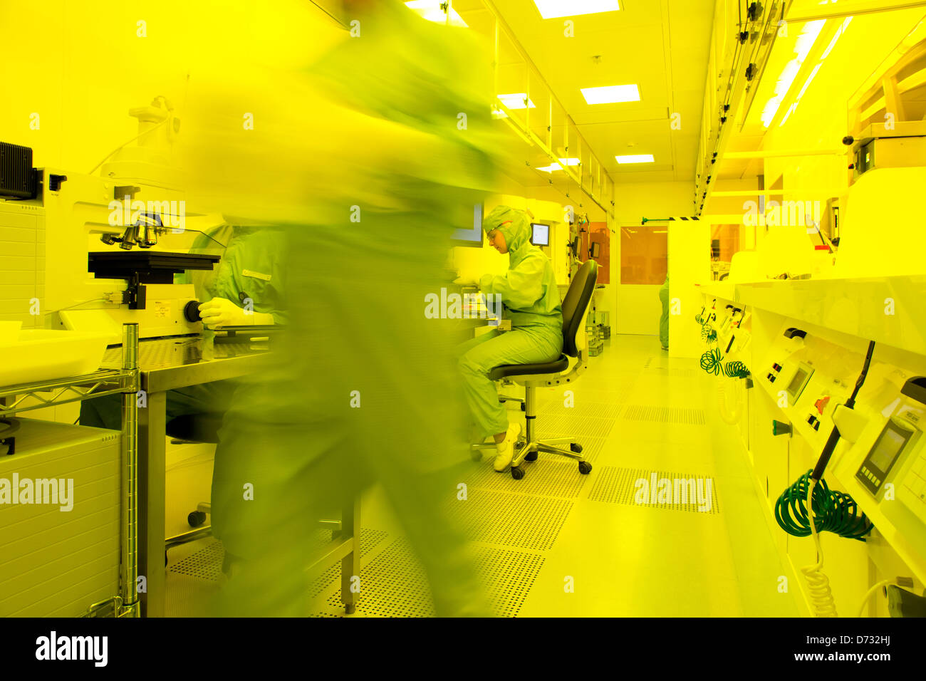 Dortmund, Germany, scientists at iX-factory work in the clean room - Stock Image
