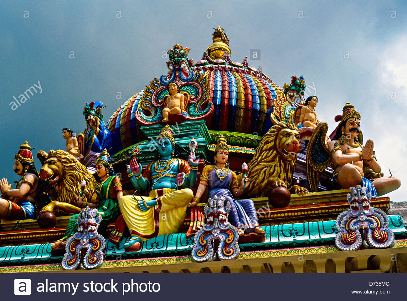 Hindu deities (sculptures) on the Gopuram, Sri Mariamman Temple (built in the South Indian Dravidian style), Singapore - Stock Image