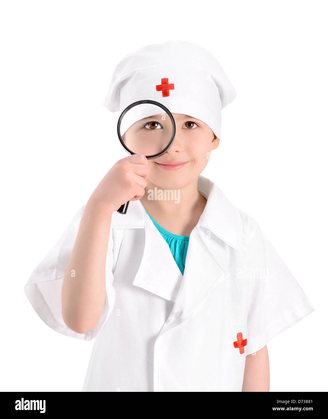 Portrait of a smiling little girl wearing as a nurse on white uniform and holding in right-hand a magnifying glass - Stock Image
