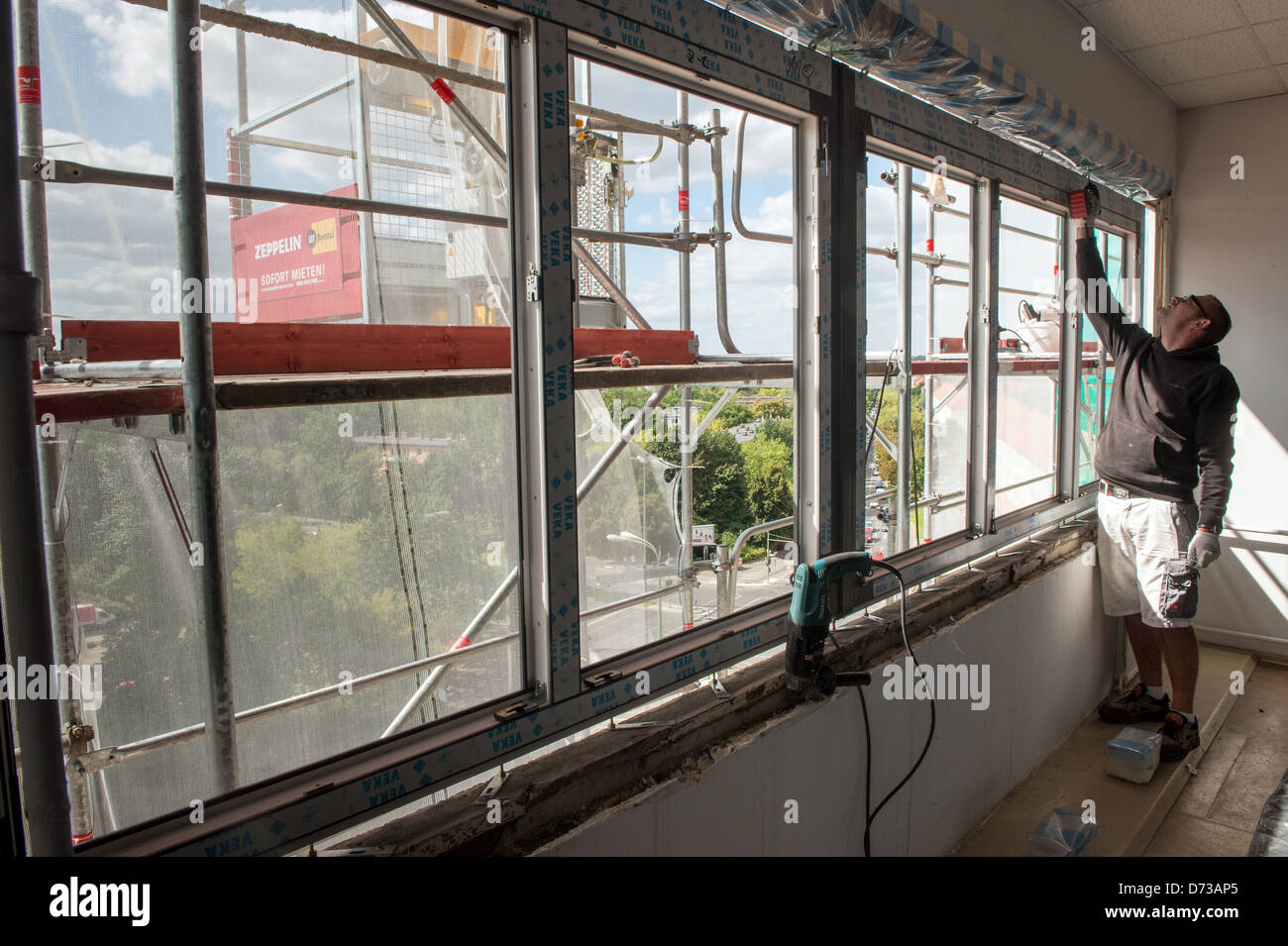 Berlin, Germany, workers assemble under a thermal window - Stock Image