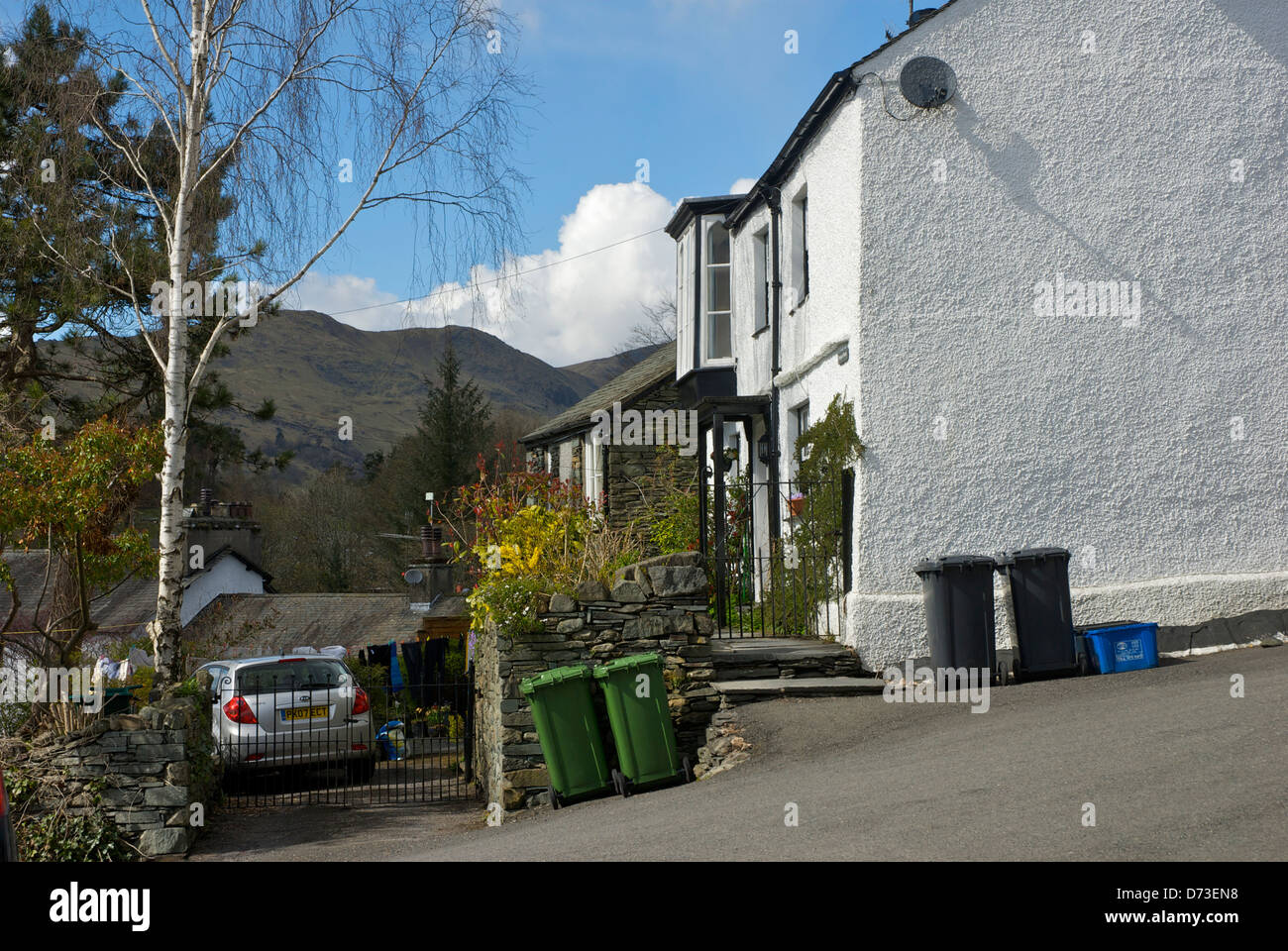 Recycling bins lined up outside a house in Ambleside, Cumbria, England UK Stock Photo
