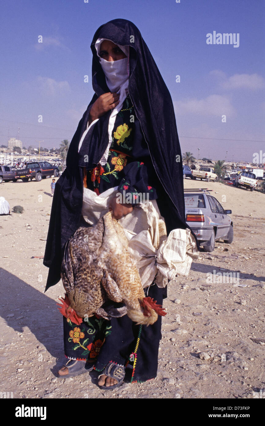 Bedouin woman from the Tarabin tribe also known as Al-Tirabin at the market in Beersheba also spelled Beer-Sheva - Stock Image