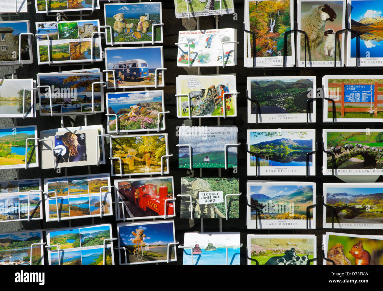 Lake District postcards in a rack, on sale outside shop, Cumbria, England UK - Stock Image