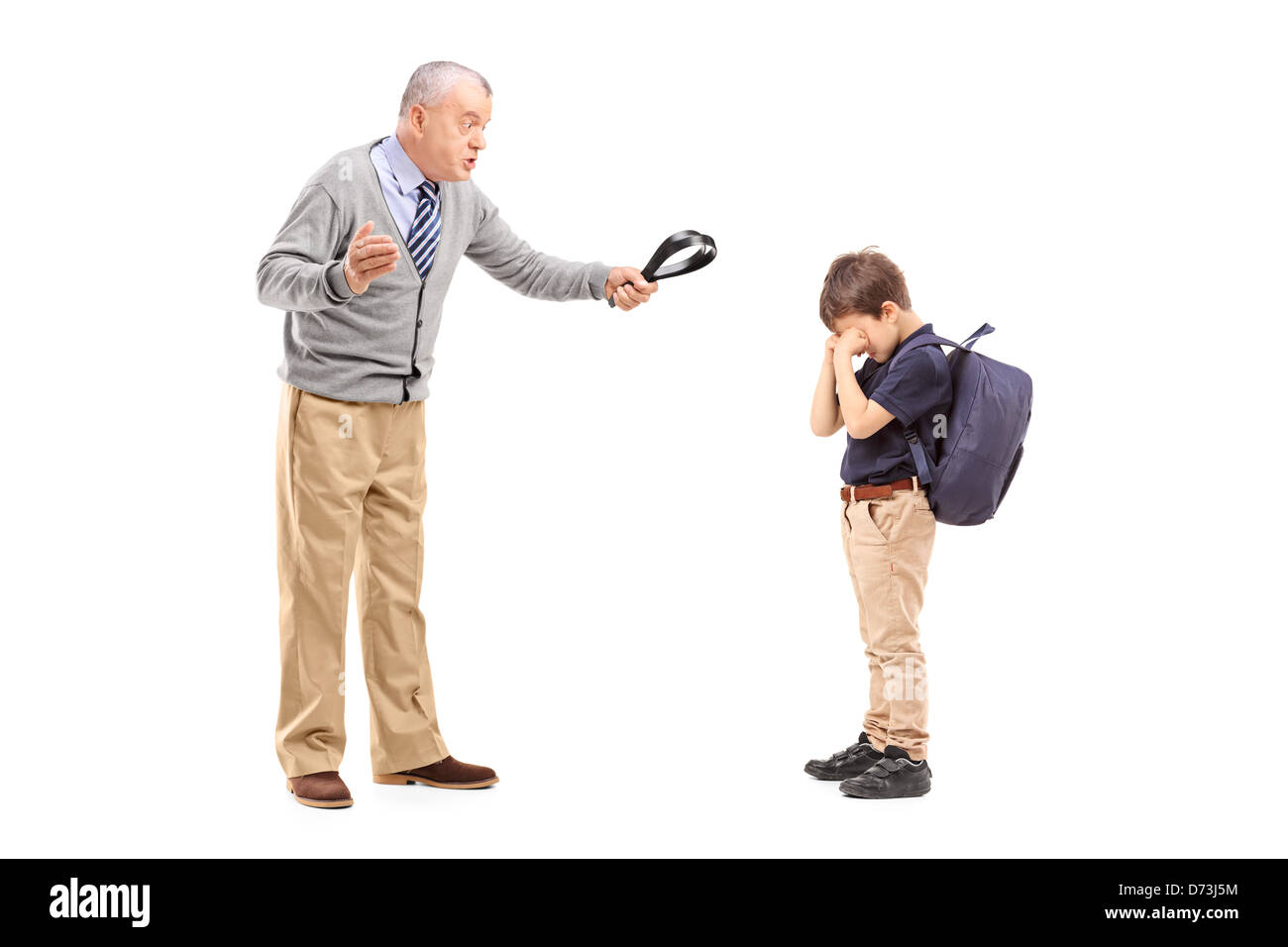 Full length portrait of an angry grandfather holding a belt and shouting at his nephew isolated on white background - Stock Image