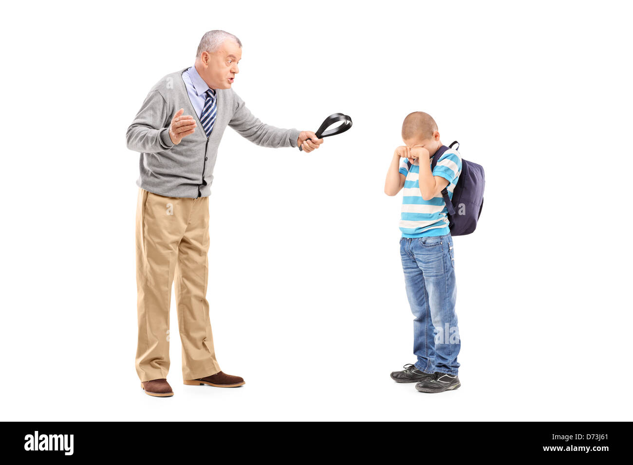 Full length portrait of an angry grandfather holding a belt and threatening on his nephew isolated on white background - Stock Image