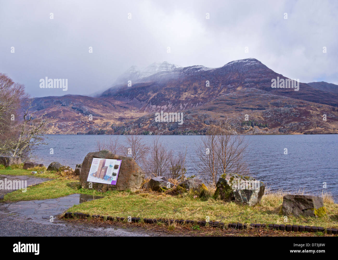 Changing April weather over Loch Maree in in Wester Ross Highland Scotland with mountain Slioch & interpretation - Stock Image