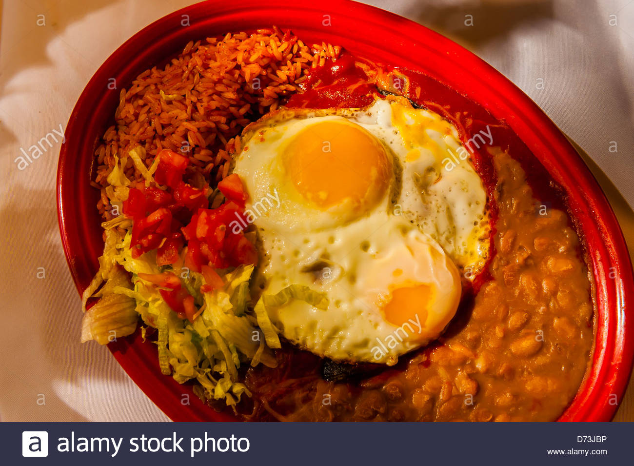Blue Corn Enchiladas with red chile with egg, El Pinto Restaurant and Cantina, Albuquerque, New Mexico USA Stock Photo