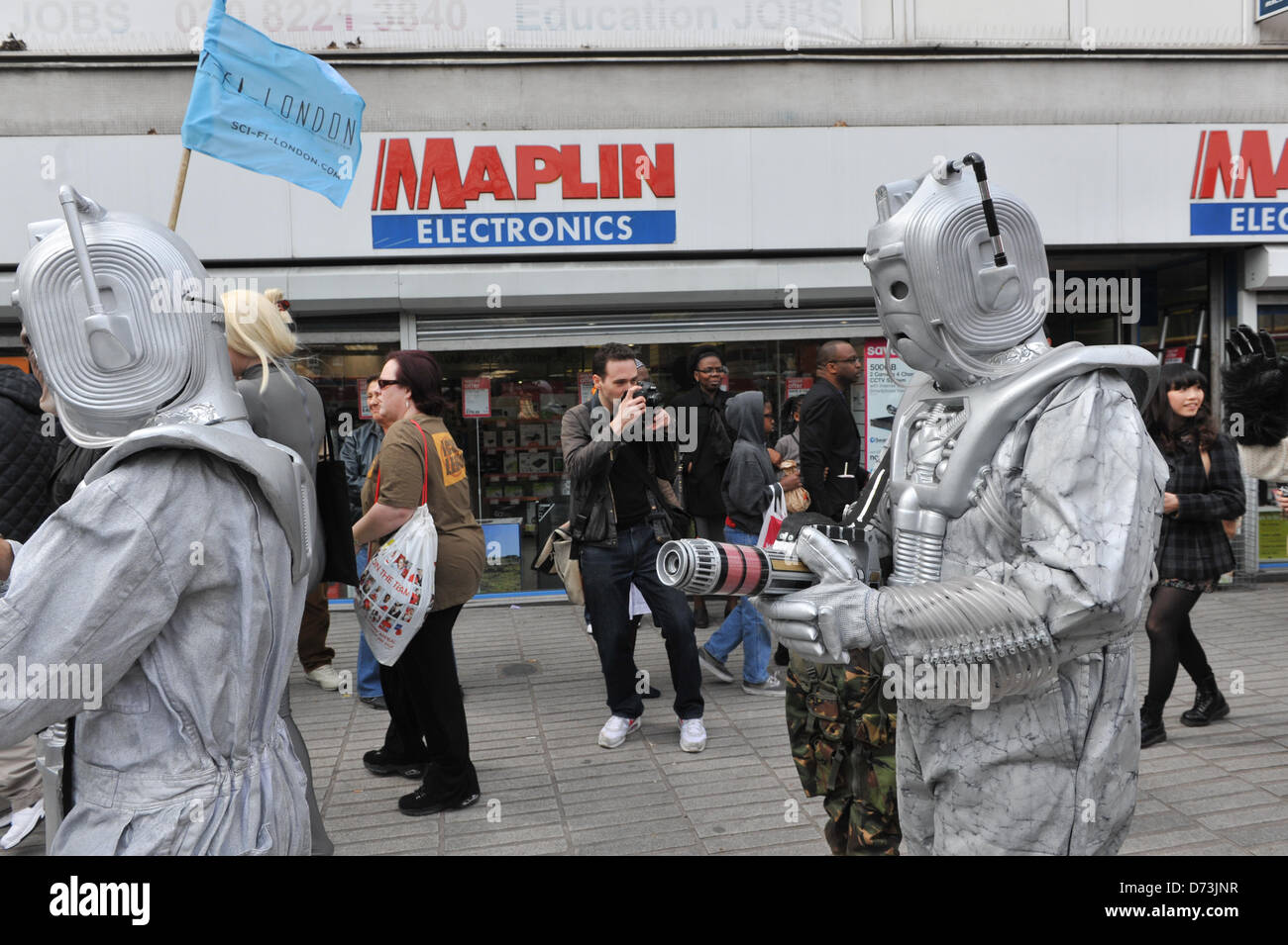 Cosplay cosplayers dressing up Stratford, London, UK. 28th April 2013. Cyberman pass Maplin Electronics at the costume - Stock Image