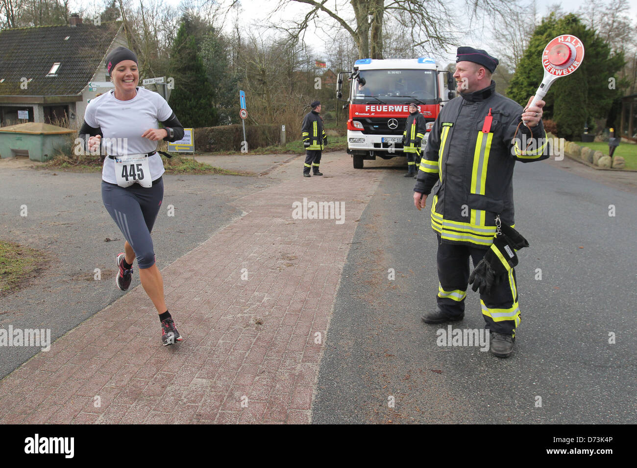 Oeversee, Germany, volunteer fire department Oeversee Frörup helps at the annual New Year's run - Stock Image