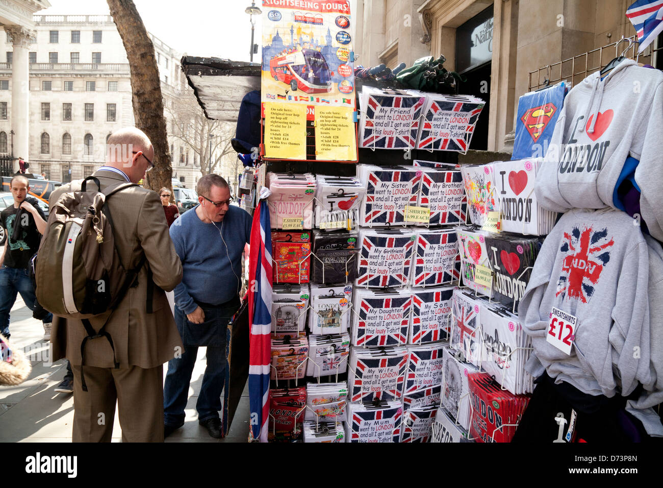 A man shopping for souvenirs and gifts at a Central London street stall, London city centre, UK - Stock Image