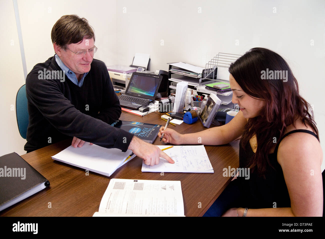 A student having extra private one to one lesson tuition with a tutor, UK - Stock Image