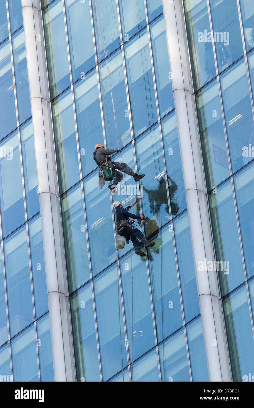 Window cleaners cleaning windows on citypoint city point tower office block in Moorgate London - Stock Image