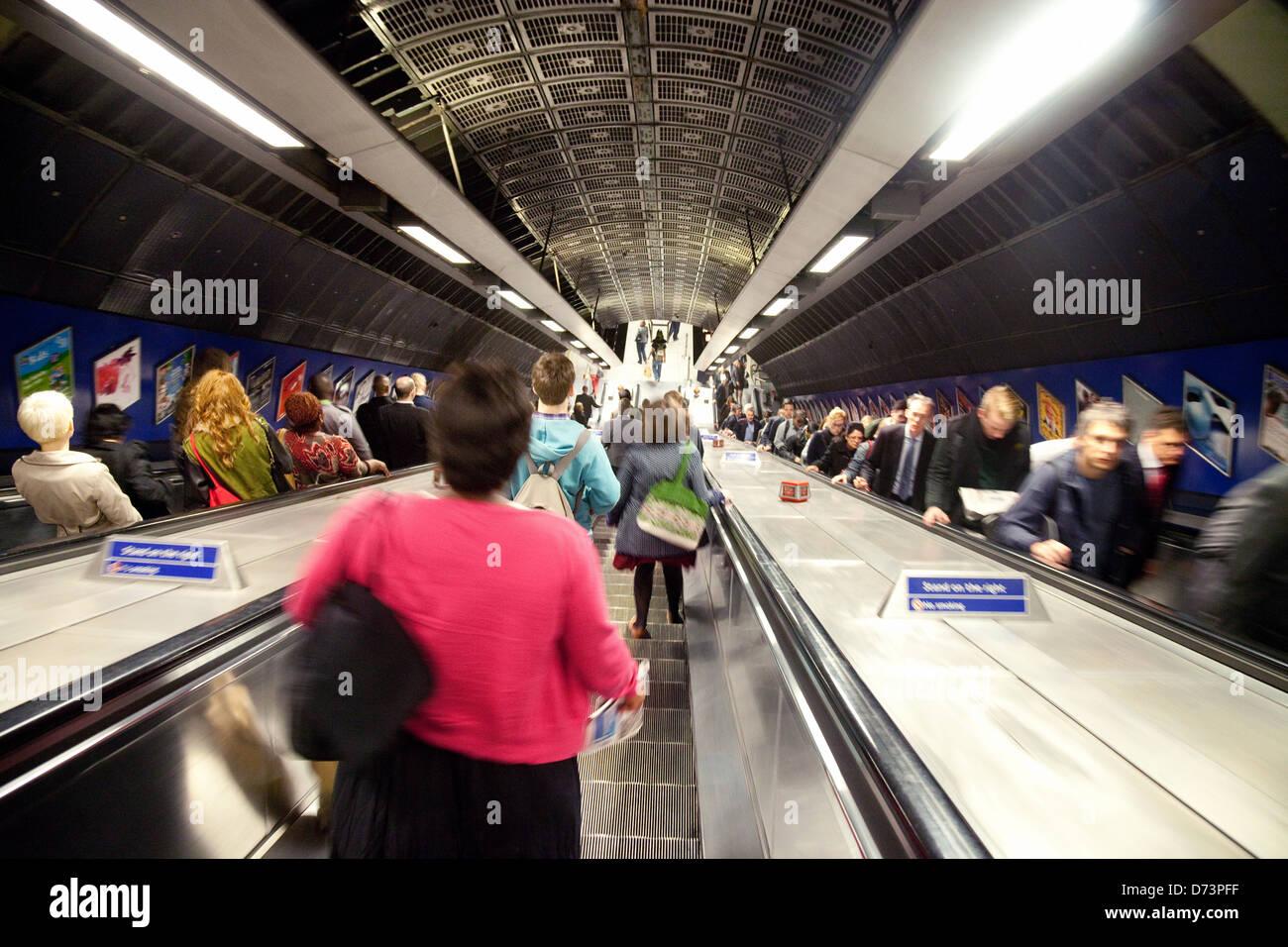 commuters commuting to work on escalators, the London Underground subway, London Bridge station, UK - Stock Image