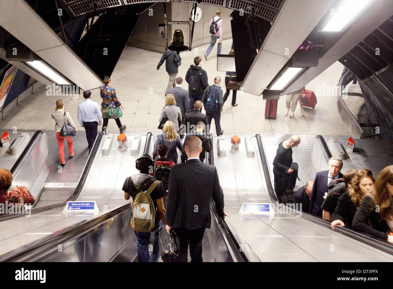 Commuters commuting to work on the London underground escalators, London Bridge Station, London UK - Stock Image