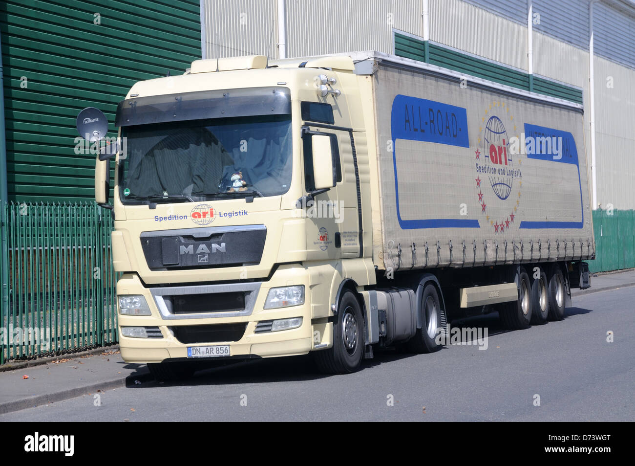 A MAN TGX 18.440 tractor unit and trailer in the livery of German carrier ARI in Leicester, Leicestershire, England Stock Photo