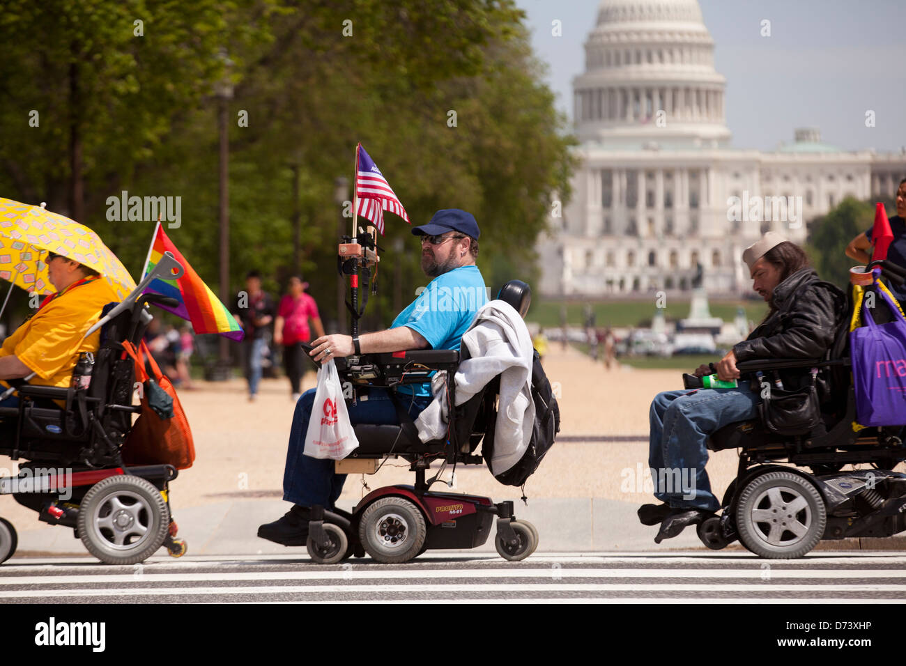 Disabled people in wheelchairs crossing the street - Washington, DC USA - Stock Image