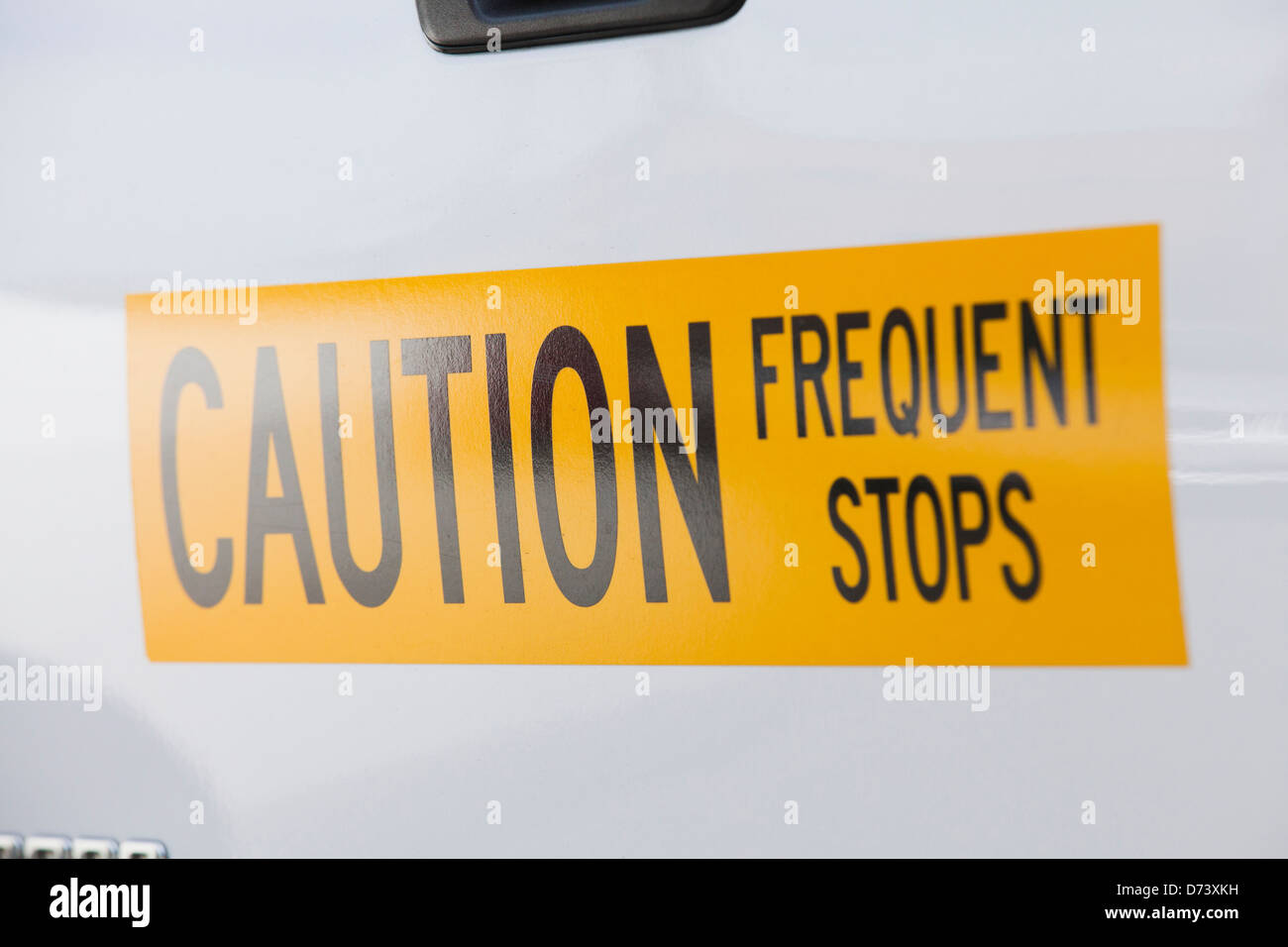 Frequent stop warning sign on back of truck - Stock Image
