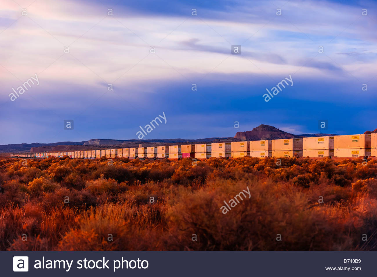 Freight train carrying containers, near Gallup, New Mexico USA. - Stock Image