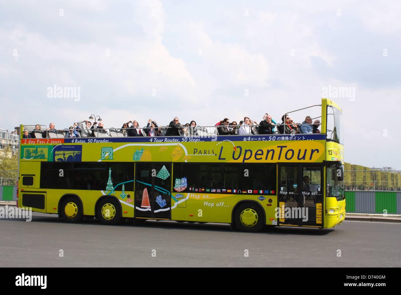 Open top tour bus in Paris, France Stock Photo