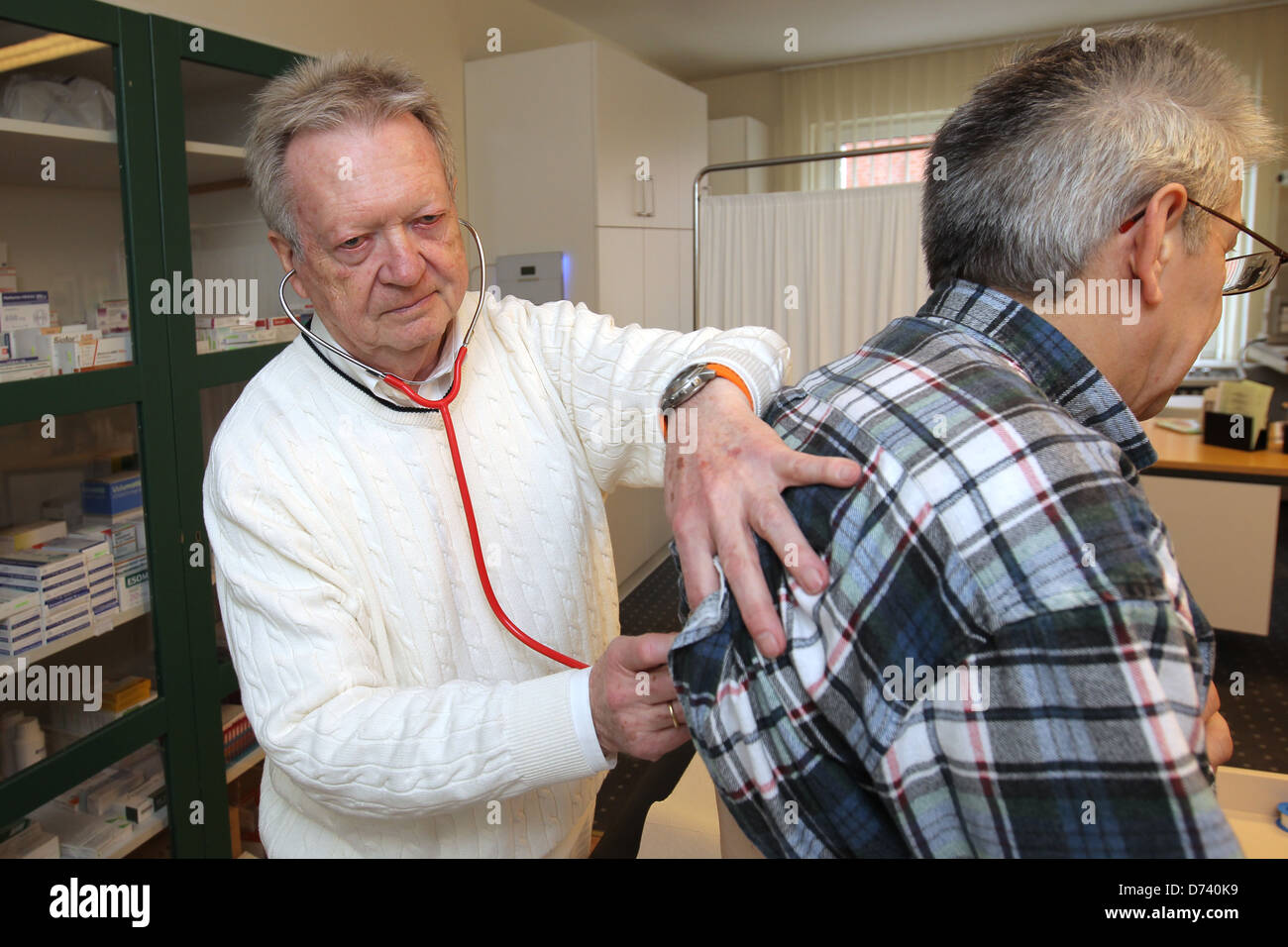 Bad Segeberg, Germany, Uwe thinker examines a patient in his practice without limits Stock Photo
