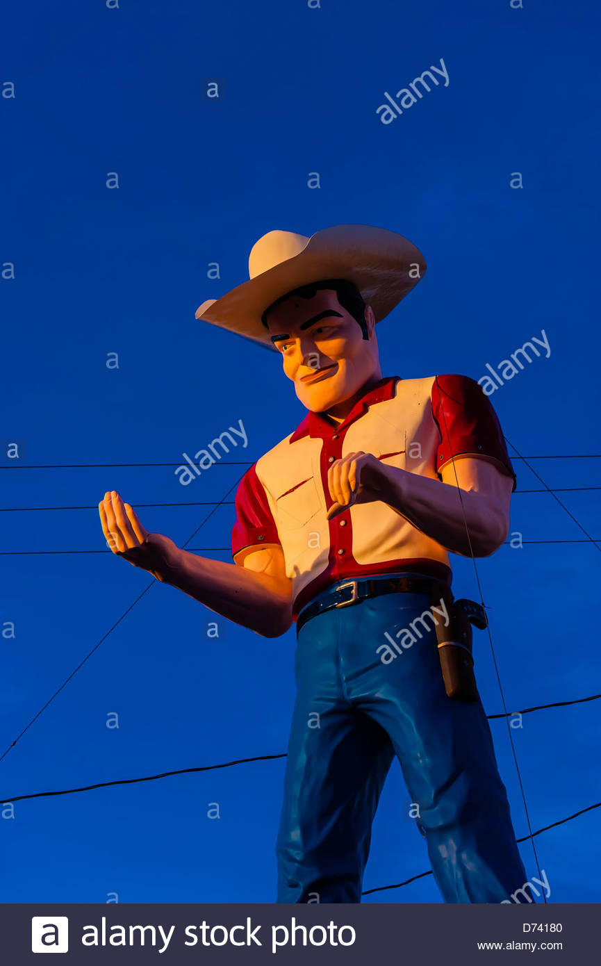 'Muffler Man' a huge cowboy atop John's Used Cars, Historic Route 66, Gallup, New Mexico USA. - Stock Image